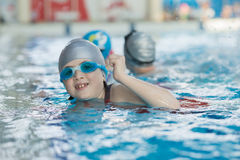 Young and successful swimmers pose Stock Photos