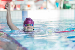 Young and successful swimmers pose Stock Photography