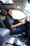 Young successful woman in the new car Stock Photo