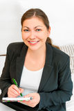 Young successful woman with a notebook Stock Images