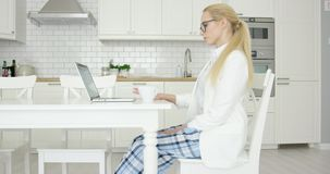 Young successful woman using laptop stock video footage