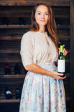 A young successful woman winemaker, businessman. A young successful woman winemaker demonstrates his wine cellar and its wine products, concept business Royalty Free Stock Photography