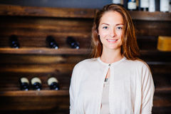 A young successful woman winemaker. Demonstrates his wine cellar and its wine products, concept business Royalty Free Stock Image