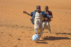 Young Sudanese boys playing football. Royalty Free Stock Image