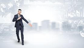 Suited karate man doing karate tricks on the top of a metropolitan city Stock Photography