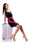 Young summer girl with travel suitcase on white Royalty Free Stock Images