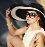 Young summer girl wearing a hat. Sensual young summer girl wearing a hat  and sunglasses Stock Images