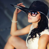 Young summer girl wearing a hat. And sunglasses Royalty Free Stock Photo