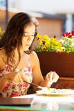 Young summer woman eating dinner. Royalty Free Stock Images
