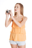 Young summer woman is taking a photo. Stock Image