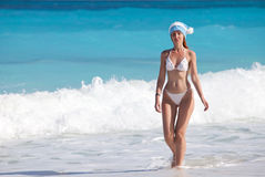 The young suntanned slender woman with a long fair hair in white sexual bikini Royalty Free Stock Images