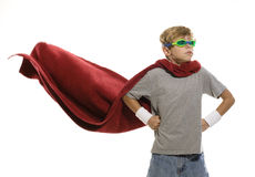 Young Super Hero. Horizontal photograph of a young child pretending to be a super hero royalty free stock photo