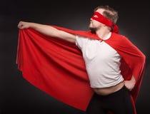 Young super hero man in studio Stock Photo