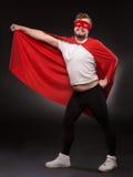 Young super hero man in studio Stock Images