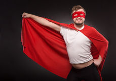 Young super hero man in studio Royalty Free Stock Images