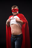 Young super hero man in studio Royalty Free Stock Photos