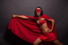 Young super hero woman in studio Stock Images