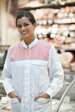Young supermarket employee Royalty Free Stock Images