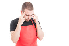 Young supermarket employee having migraine Stock Photos