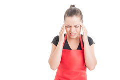 Young supermarket seller suffering from headache Royalty Free Stock Image