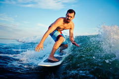 Young surfboarder Stock Images