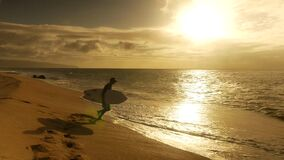 Young surfer on the beach waiting for perfect waves