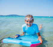 Young surfer girl Stock Images