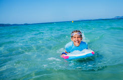 Young surfer girl Stock Image