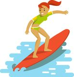 Young surfer girl on surfboard riding the wave Stock Image