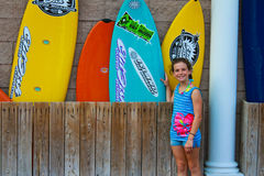 Young surfer next to surfboards Stock Images