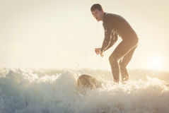 Young surfer practicing surf in Manhattan beach Royalty Free Stock Image