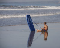 Young Surfer Reflecting Stock Images