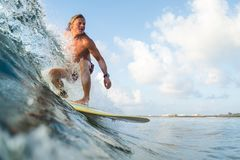Young surfer. Rides ocean wave stock photo