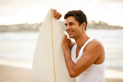 Young surfer standing with his surfboard. Young Italian surfer standing on the beach with his surfboard Stock Photography