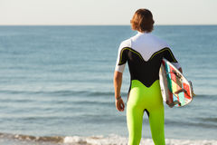 Young surfer about to get into the sea Stock Photo