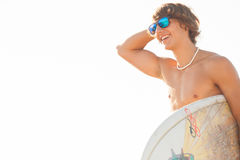 Young surfer about to get into the sea Royalty Free Stock Photos
