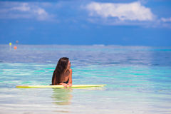 Young surfer woman surfing during beach vacation Stock Images
