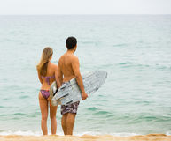 Young surfers couple on the beach Royalty Free Stock Photography