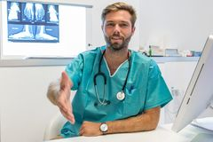 Young surgeon doctor reaches out to us, close up hand royalty free stock photo