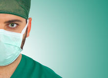Young surgeon gazing and looking at camera Stock Photo