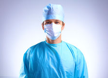Young surgeon holding a scalpel. Ready for operation.  Stock Photos