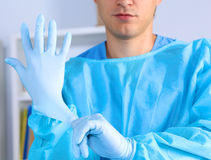 Young surgeon holding a scalpel. Ready for operation Royalty Free Stock Photos