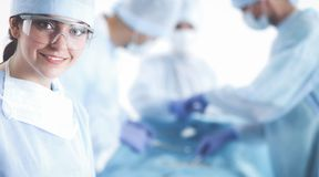 Young surgery team in the operating room.  Stock Photo