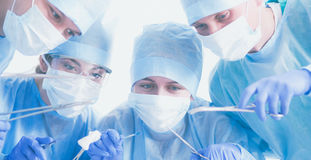 Young surgery team in the operating room.  Stock Images