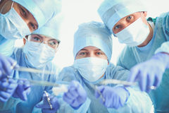 Young surgery team in the operating room.  Royalty Free Stock Photo