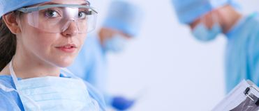 Young surgery team in the operating room . Operating room.  Stock Photo