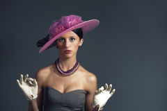 Young surprise stylich woman with purple retro hat Stock Photo