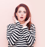 Young surprised beautiful caucasian woman. On pink background Royalty Free Stock Image