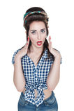Young surprised beautiful woman in retro pin-up style isolated. Over white Royalty Free Stock Photo