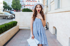 Young surprised brunette woman looking at camera outdoors Royalty Free Stock Photography